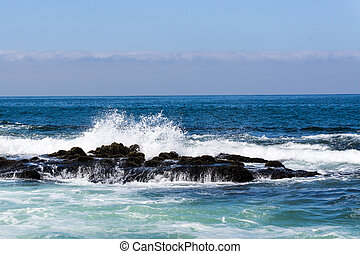 Pacific Ocean with Waves Crashing onto Rocks