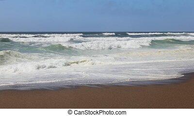 Pacific Surf Loop - Pacific Ocean Waves roll in and break on...