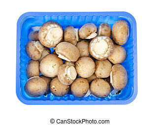 Pack of blue with fresh brown champignons.