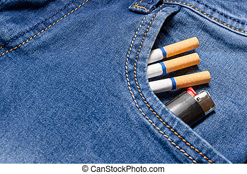 Pack of cigarettes and lighter in pocket jeans