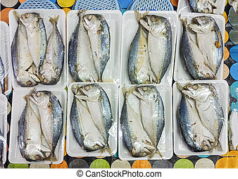 Pack of Thai Mackerel fish in foam plate, Top view