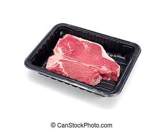 Packaged T Bone Steak - A T Bone steak in a plastic ...