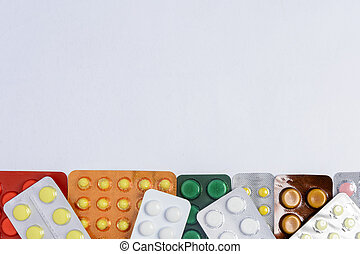 Packages of pills on a white background with a place for the inscription