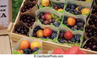 Packages with fresh fruit in box on wedding day in forest