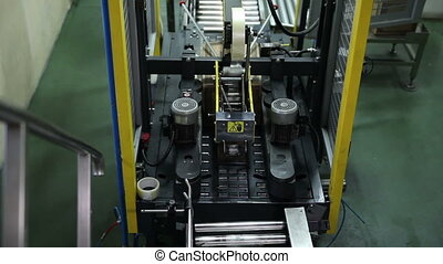 Packaging Butter - Cartons in The Workplace. Packaging of...
