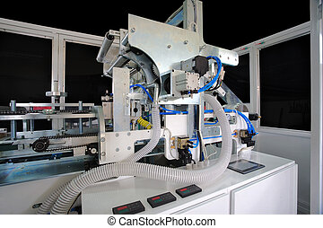 Packaging machine for rolls, serviettes and handkerchiefs.
