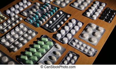 Packaging of tablets and pills on the table