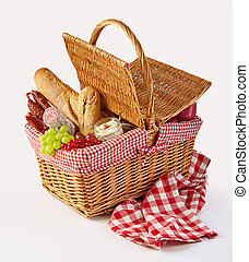 Packed picnic lunch in a wicker basket