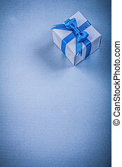 Packed present box with bow on blue background