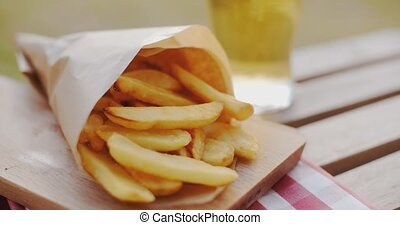 Packet of takeaway French fries or potato chips lying...