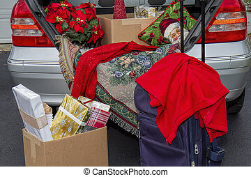 Packing car trunk with gifts to get away for the Christmas...