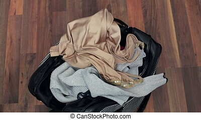 Packing clothes in bag