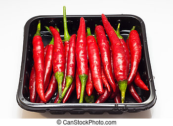 Packing of chili peppers on a white background