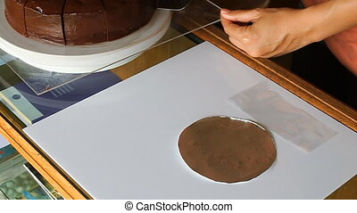 Packing piece of chocolate cake