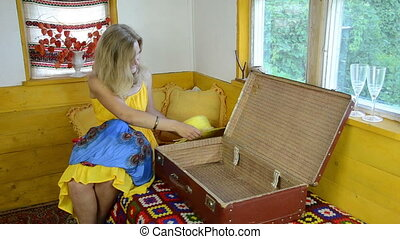 packing suitcase girl