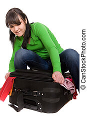 packing woman - woman packs her clothes. over white ...