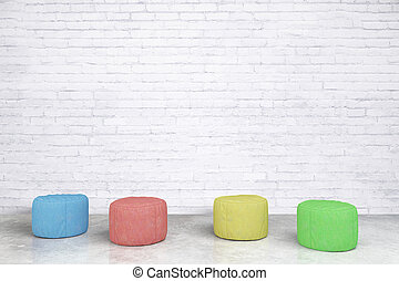 Padded stools in brick room