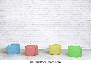 Padded stools in brick room