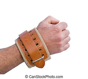 padded leather wrist restraint on an arm isolated over a white background
