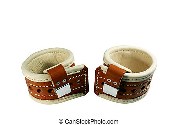 padded leather wrist restraints isolated with clipping path at this size