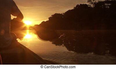 Paddeling -Boat On Amazon in Sunset - Sunset On Amazon River