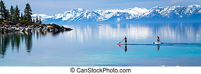 Paddle boarding on calm waters