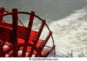 Paddle boat wheel - Riverboat red paddle boat wheel in...