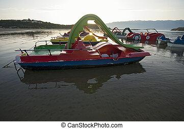 Paddle boats at sunrise