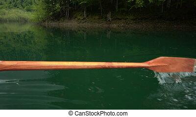 paddle raking water in the lake, detail