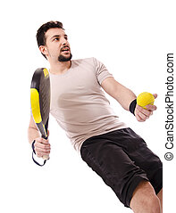 Paddle serve - Isolated sportsman doing a paddle tenis serve
