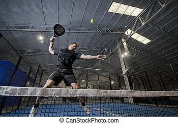 Paddle tennis smash - Paddle tennis player jumping and...