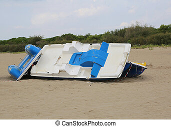 paddleboat destroyed on the beach - pedal? destroyed after...