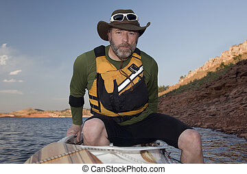 paddler boarding his canoe