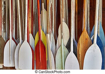Paddles In Storage - Many canoe paddles hanging in a shed
