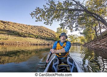 paddling expedition canoe on lake POV