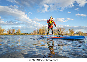 paddling stand up paddleboard in Colorado