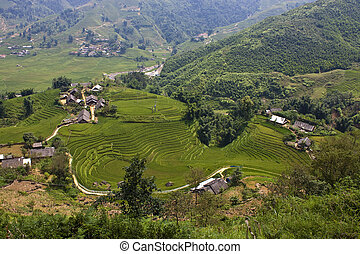 Paddy fields and small villages in mountains of northern...