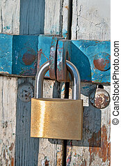 Padlock and chain on old wooden door