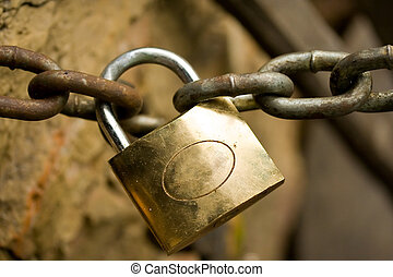Padlock and chain - Rusty padlock tied on a big chain