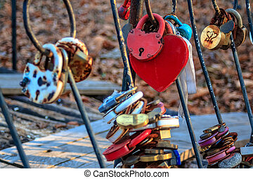 Padlock as a sign of eternal love newlyweds mounted on the bridge.