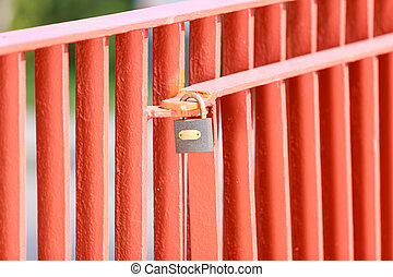 Padlock locked on bridge.