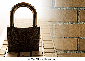 padlock on a computer keyboard with brick wall Internet security concept