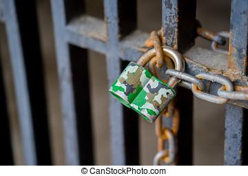 padlock on a rusty door
