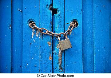 Padlock on blue door.