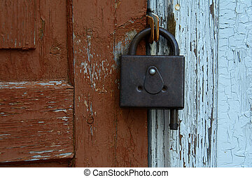 padlock on brown and blue background - padlock on the old...