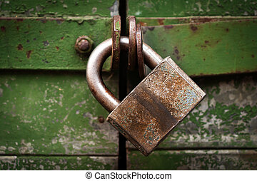 Padlock on door - Closed metal lock door security protection...