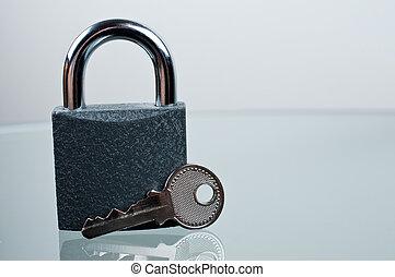 Padlock with a key on desk