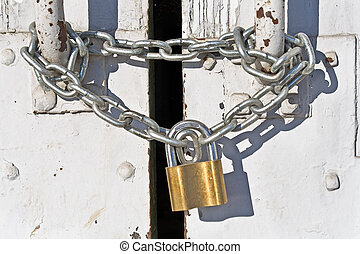 Padlock with chain on old door