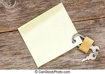 Padlock with empty sticky note