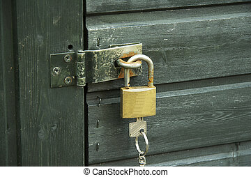 padlock with key 01 - padlock with bolt at a gate